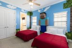 The kids will sleep comfortably in this themed full/full bedroom